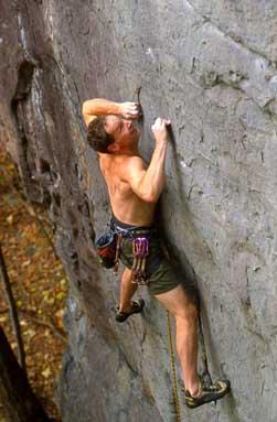 mountain climber gripping rocks