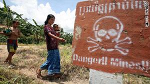Khmer women walking in mined field
