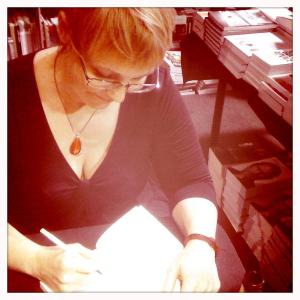 signing books at launch