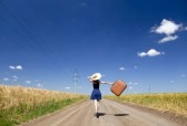 lonely-girl-with-suitcase-at-country-road