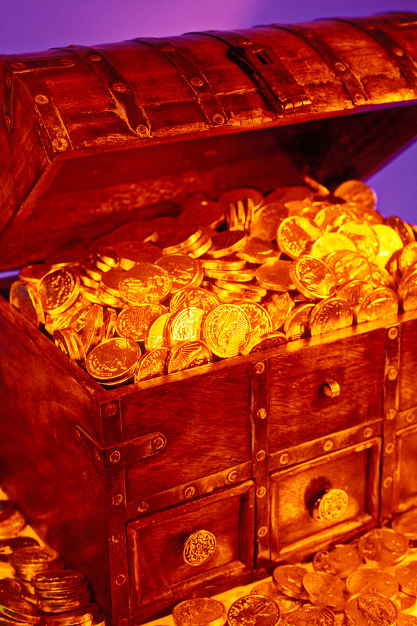 Treasure chest with gold coins by Garry Gay