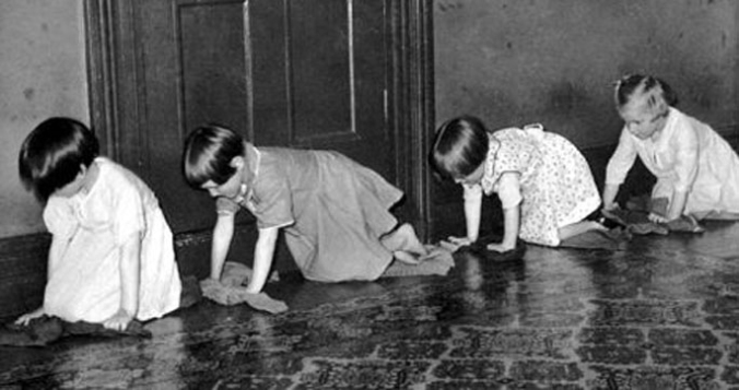 Girls in an orphanage scrubbing floors