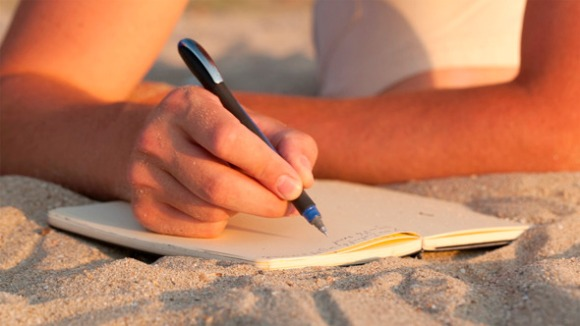 writing at beach