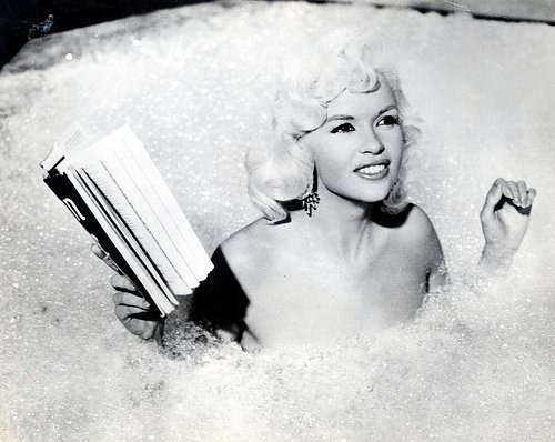 Jayne Mansfield reading in bath