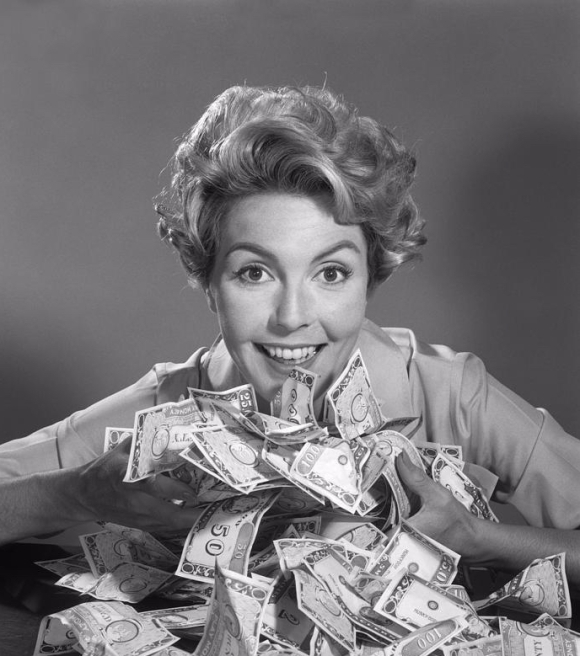 woman-with-money-c1950-60s-debrockeclassicstock